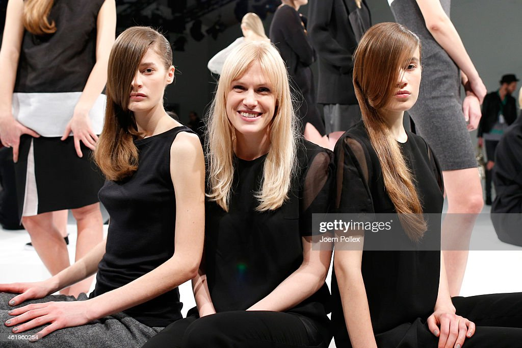 Designer Margit Peura (C) poses with models at the Whitetail show during the Mercedes-Benz Fashion Week Berlin Autumn/Winter 2015/16 at Brandenburg Gate on January 22, 2015 in Berlin, Germany.