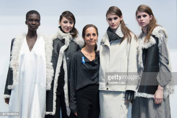 Designer Maria Cornejo in black dress poses with models for Zero Maria Cornejo Presentation February 2018 New York Fashion Week on February 12 2018...