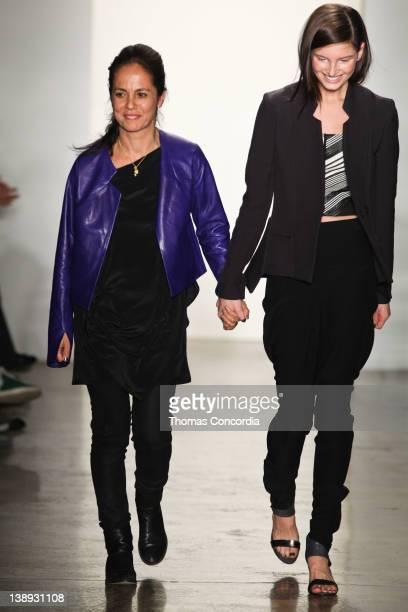 Designer Maria Cornejo walks the runway with a model after the Zero + Maria Cornejo Fall 2012 fashion show during Mercedes-Benz Fashion Week at Milk...
