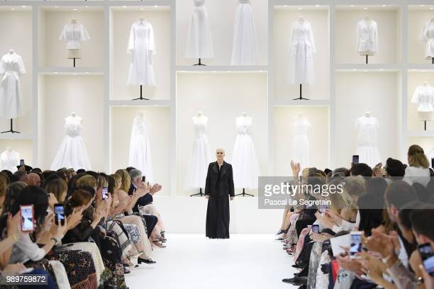 Designer Maria Grazia Chiuri acknowledges the sqlute of the public after her Christian Dior Haute Couture Fall Winter 2018/2019 show as part of Paris...