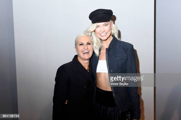 Designer Maria Grazia Chiuri and Karlie Kloss pose backstage after the Christian Dior show as part of the Paris Fashion Week Womenswear Spring/Summer...