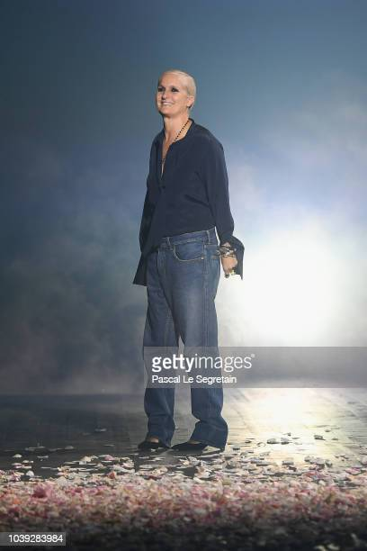 Designer Maria Grazia Chiuri arrives on the runway at the end of the Christian Dior show as part of the Paris Fashion Week Womenswear Spring/Summer...