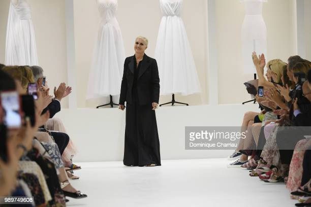 Designer Maria Grazia Chiuri arrives on the runway during the Christian Dior Haute Couture Fall/Winter 20182019 show as part of Haute Couture Paris...