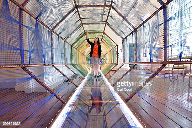 Designer Maria Levene who is representing Spain poses for photographs in her installation entitled 'VRPolis Driving into the Future' at the London...