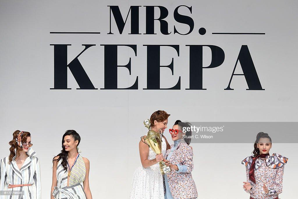 Designer Mariam Yehia hugs Natalia Shustova at the runway during the Mrs. Keepa Presentation at Fashion Forward Spring/Summer 2017 held at the Dubai Design District on October 22, 2016 in Dubai, United Arab Emirates.