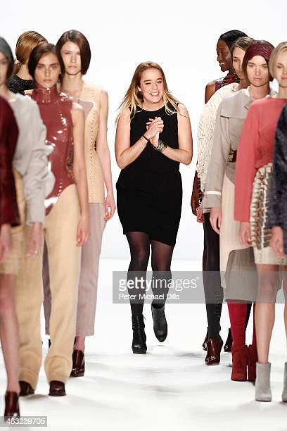 Designer Marina Hoermanseder acknowledges the audience after the Marina Hoermanseder show during MercedesBenz Fashion Week Autumn/Winter 2014/15 at...