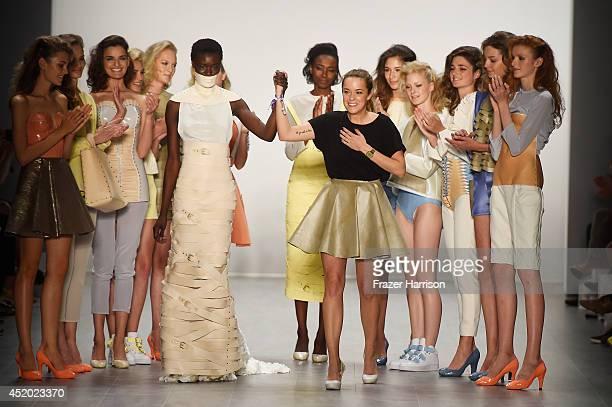 Designer Marina Hoermanseder appears on the runway at the Marina Hoermanseder show during the Mercedes-Benz Fashion Week Spring/Summer 2015 at Erika...
