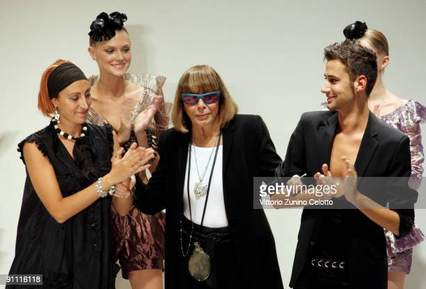 Designer Mariuccia Mandelli acknowledges the applause of the public after the Krizia fashion show as part of Milan Womenswear Fashion Week...