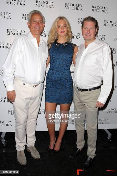 Designer Mark Badgley Erin Heatherton and designer James Mischka backstage at the Badgley Mischka fashion show during MercedesBenz Fashion Week...