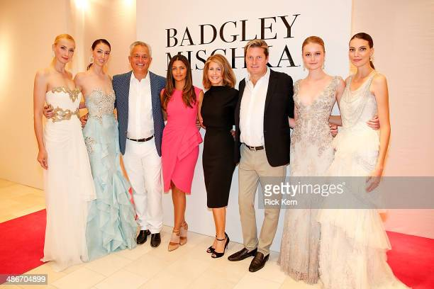 Designer Mark Badgley host Camila Alves McConaughey Jennifer Carnes designer James Mischka and models pose at the Badgley Mischka Fashion Event...