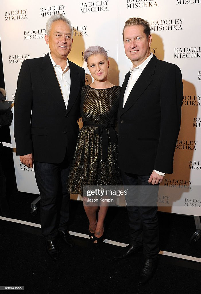 Designer Mark Badgley, Kelly Osbourne and designer James Mischka pose backstage at the Badgley Mischka Fall 2012 fashion show during Mercedes-Benz Fashion Week at The Theatre at Lincoln Center on February 14, 2012 in New York City.