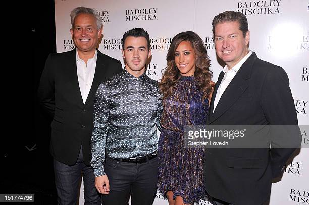 Designer Mark Badgley musician Kevin Jonas Danielle Deleasa and James Miscka pose backstage at the Badgley Mischka show during the Spring 2013...