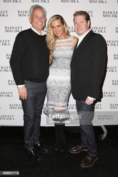 Designer Mark Badgley Petra Nemcova and designer James Mischka pose backstage at the Badgley Mischka fashion show during MercedesBenz Fashion Week...