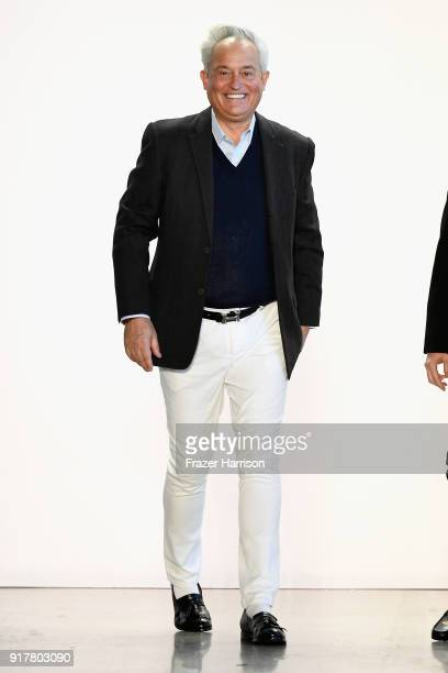 Designer Mark Badgley takes a bow on the runway for Badgley Mischka during New York Fashion Week The Shows at Gallery I at Spring Studios on February...