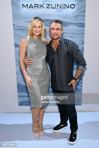 Designer Mark Zunino and actress Alyshia Ochse attend front row at The Mark Zunino For Kleinfeld 2015 Runway Show at Kleinfeld on October 14 2014 in...