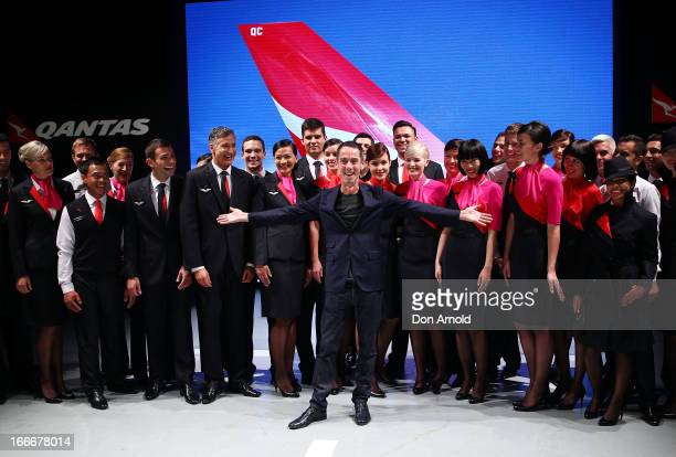 Designer Martin Grant poses alongside Qantas staff during the Qantas uniform unveiling at Hordern Pavilion on April 16 2013 in Sydney Australia