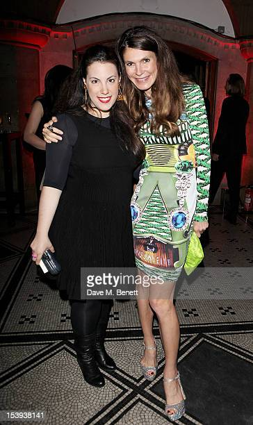 Designer Mary Katrantzou and founder of the Emdash Foundation Andrea Dibelius attend a private dinner hosted by Matthew Slotover and Amanda Sharp to...