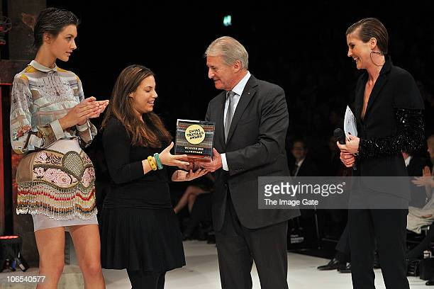 Designer Mary Katrantzou winner of the Swiss Textiles Awards 2010 receives her trophy from Swiss Textiles President Max R Hungerbuhler and Annina...