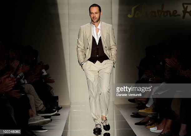 Designer Massimiliano Giornetti acknowledge the applause of the public after the Salvatore Ferragamo Milan Menswear Spring/Summer 2011 show on June...