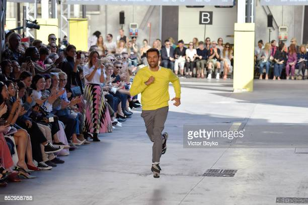 Designer Massimo Giorgetti acknoledges the applause of the public after the MSGM show during Milan Fashion Week Spring/Summer 2018 on September 24...