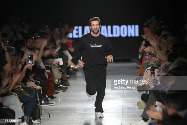 Designer Massimo Giorgetti acknowledges the applause of the audience at the MSGM show at Milan Fashion Week Autumn/Winter 2019/20 on February 22,...