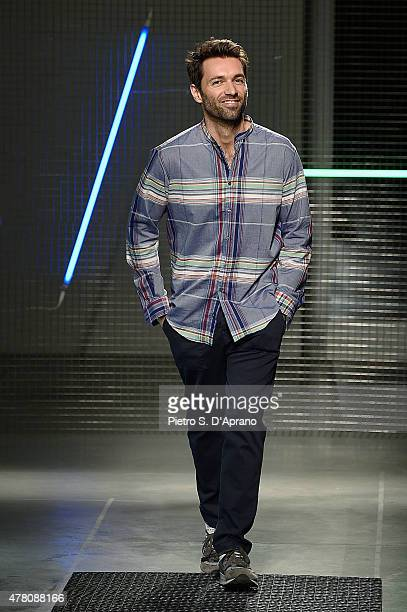 Designer Massimo Giorgetti acknowledges the applause of the audience after the MSGM fashion show as part of Milan Men's Fashion Week Spring/Summer...