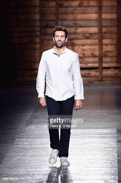 Designer Massimo Giorgetti acknowledges the applause of the audience after the Emilio Pucci fashion show as part of Milan Fashion Week Spring/Summer...