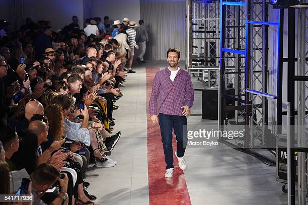 Designer Massimo Giorgetti acknowledges the applause of the audience at the end of MSGM show during Milan Men's Fashion Week Spring/Summer 2017 on...