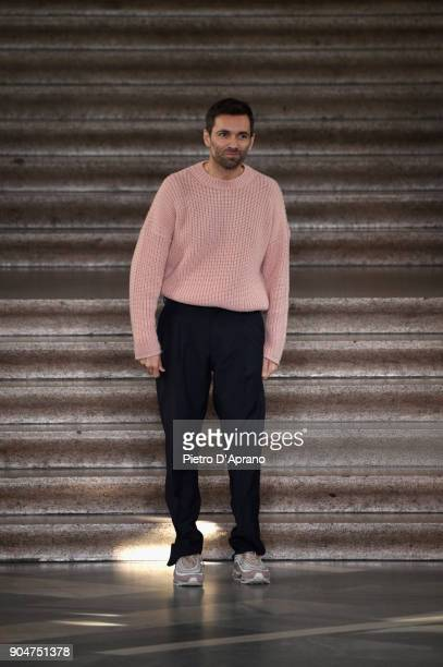 Designer Massimo Giorgetti acknowledges the applause of the audience at the MSGM show during Milan Men's Fashion Week Fall/Winter 2018/19 on January...