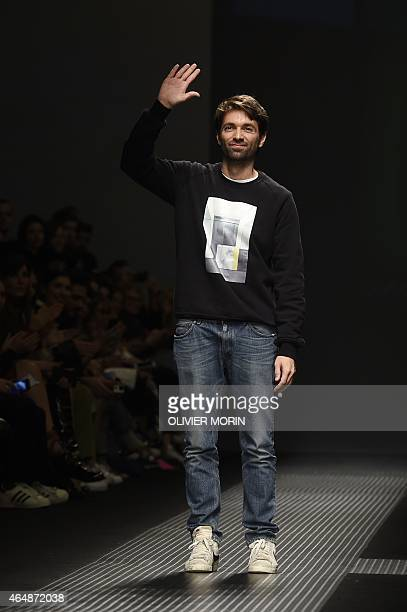 Designer Massimo Giorgetti greets the audience at the end of the show for fashion house MSGM at the women Fall / Winter 2015/16 Milan's Fashion Week...