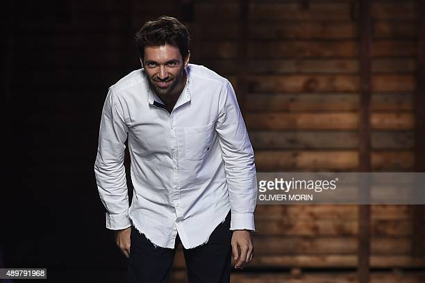 Designer Massimo Giorgetti greets the audience at the end of the show for fashion house Emilio Pucci during the women Spring / Summer 2016 Milan's...