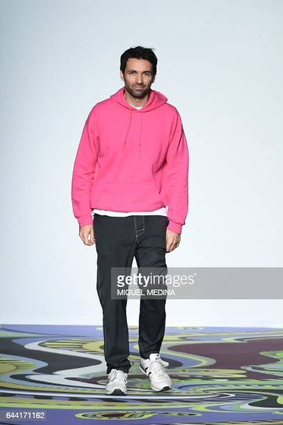Designer Massimo Giorgetti greets the audience at the end of the show for fashion house Emilio Pucci during the Women's Fall/Winter 2017/2018 fashion...