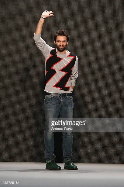 Designer Massimo Giorgetti smiles during the MSGM Di Massimo Giorgetti Show during the first day of the Mercedes-Benz Fashion Days at Schiffbau on...