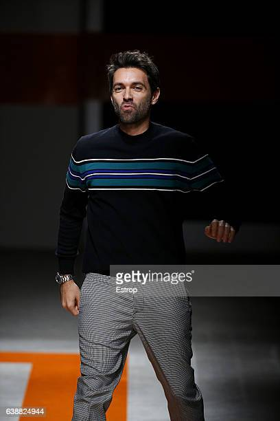 Designer Massimo Giorgetti walks the runway at the MSGM show during Milan Men's Fashion Week Fall/Winter 2017/18 on January 16 2017 in Milan Italy