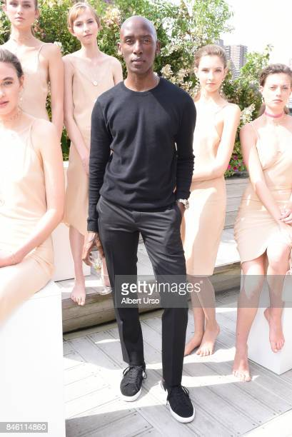 Designer Mateo poses with models at the Mateo New York presentation during New York Fashion Week at The Roxy Hotel on September 12 2017 in New York...