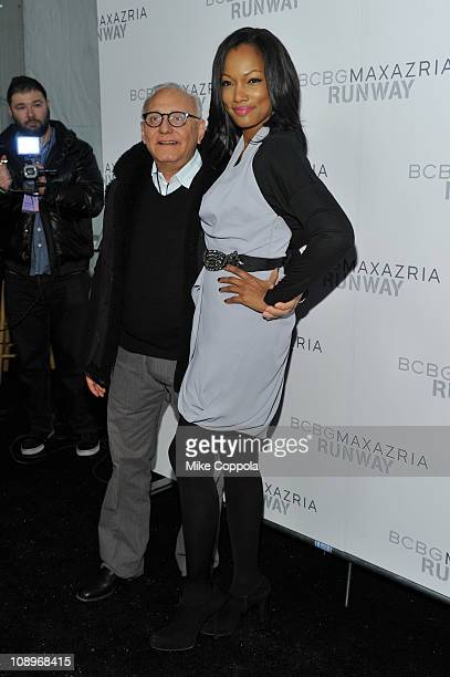 Designer Max Azria and actress Garcelle Beauvais pose backstage at the BCBGMAXAZRIA Fall 2011 fashion show during MercedesBenz Fashion Week at The...