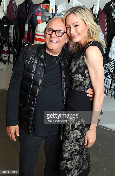 Designer Max Azria and his wife Chief Creative Officer of BCBGMAXAZRIAGROUP Lubov Azria attend attending BCBG Max Azria's Grand Opening Event Living...