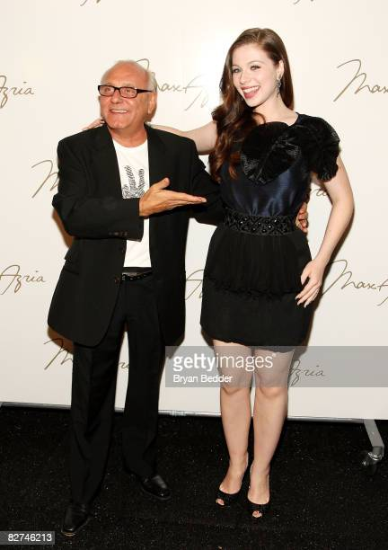 Designer Max Azria and Michelle Trachtenberg pose backstage at the Max Azria Spring 2009 fashion show during MercedesBenz Fashion Week at The Tent...
