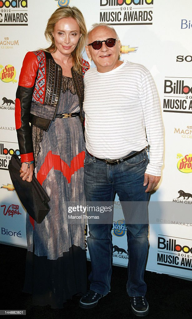 Designer Max Azria and wife Lubov Azria attend the Billboard Music Awards Pre-Party hosted by Kelly Clarkson at MGM Grand on May 19, 2012 in Las Vegas, Nevada.