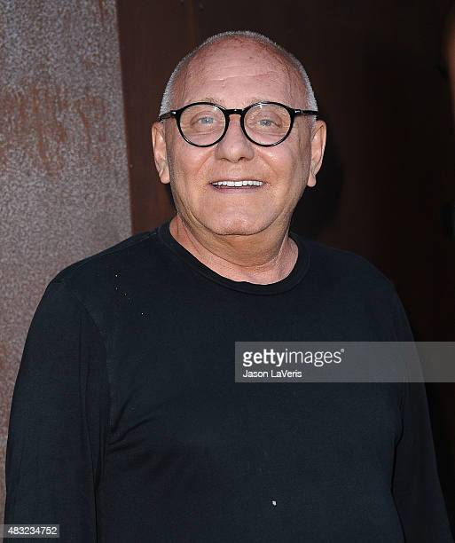 Designer Max Azria attends the BCBG Max Azria Resort 2016 collections at Samuel Freeman Gallery on August 6 2015 in Los Angeles California