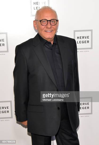 Designer Max Azria poses backstage at the Herve Leger By Max Azria fashion show during MercedesBenz Fashion Week Spring 2015 at The Theatre at...
