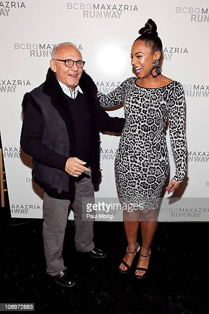 Designer Max Azria poses for a photo with Ashanti backstage at the BCBG Max Azria Fall 2011 fashion show during Mercedes-Benz Fashion Week at The...