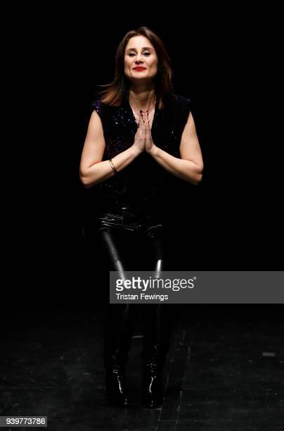 Designer Meltem Ozbek acknowledges the applause of the audience after her show during Mercedes Benz Fashion Week Istanbul at Zorlu Performance Hall...
