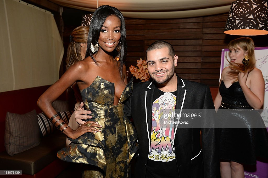 Designer Michael Costello (R) and Tia Shipman arrive for A la mode Productions Presents Designers Night Out at Sofitel Hotel on October 3, 2013 in Los Angeles, California.