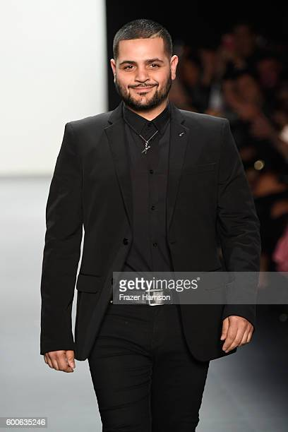 Designer Michael Costello greets the audience at the Michael Costello fashion show during New York Fashion Week The Shows September 2016 at The Dock...