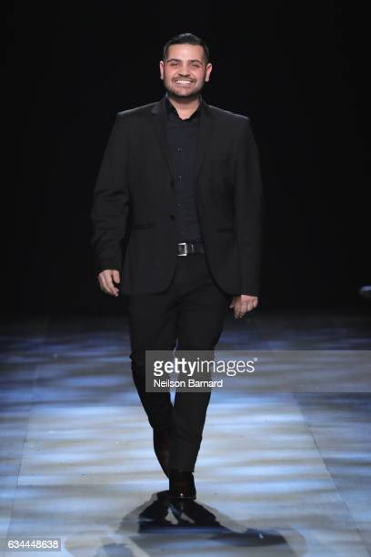 Designer Michael Costello walks the runway at the Michael Costello show during New York Fashion Week The Shows at Gallery 1 Skylight Clarkson Sq on...