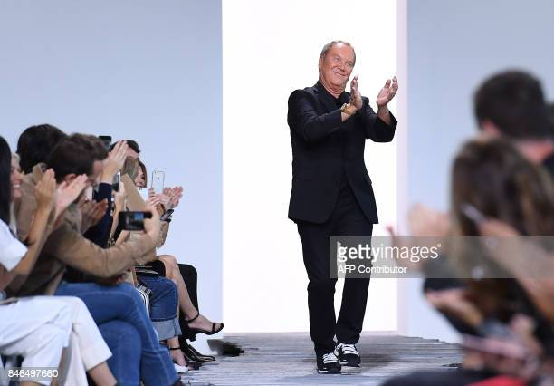 Designer Michael Kors acknowledges the audience at his Michael Kors Collection Spring 2018 Runway Show at Spring Studios on September 13 during New...