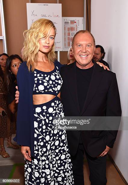 Designer Michael Kors and a guest backstage at the Michael Kors Spring 2017 Runway Show during New York Fashion Week at Spring Studios on September...