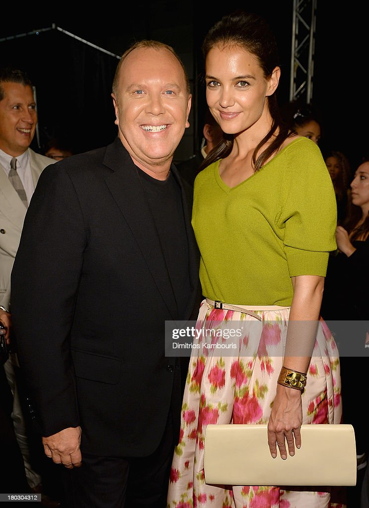 Designer Michael Kors (L) and actress Katie Holmes pose backstage at the Michael Kors fashion show during Mercedes-Benz Fashion Week Spring 2014 at The Theatre at Lincoln Center on September 11, 2013 in New York City.
