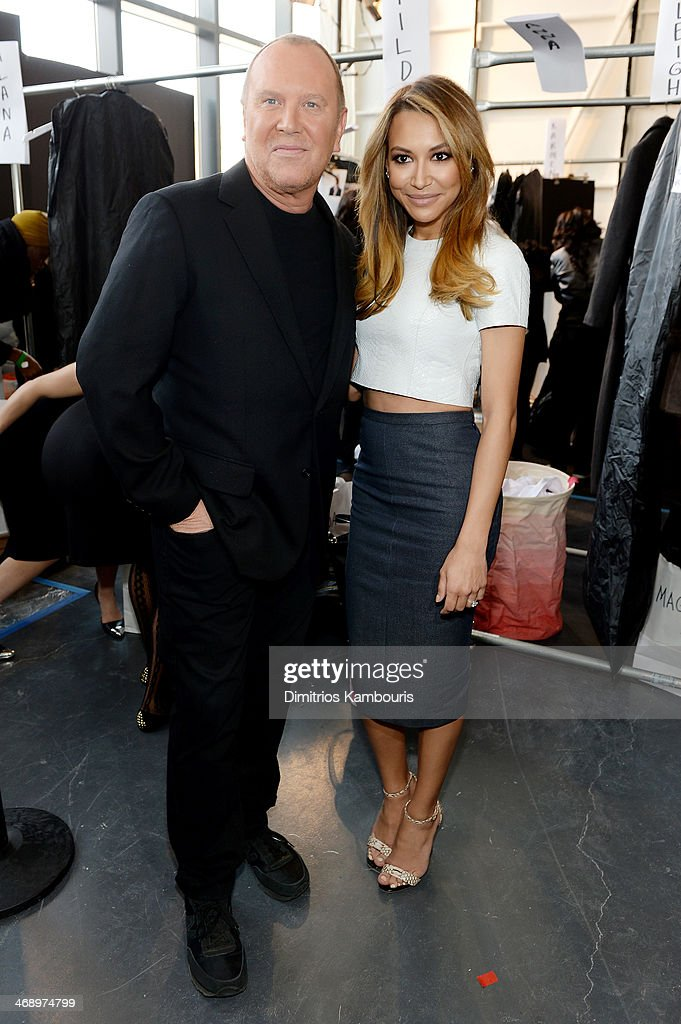 Designer Michael Kors (L) and actress Naya Rivera poses backstage at the Michael Kors fashion show during Mercedes-Benz Fashion Week Fall 2014 at Spring Studios on February 12, 2014 in New York City.